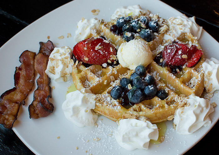 Berries and Lemon Curd Waffle with a Side of Bacon at JavaVino in La Crosse, Wisconsin.