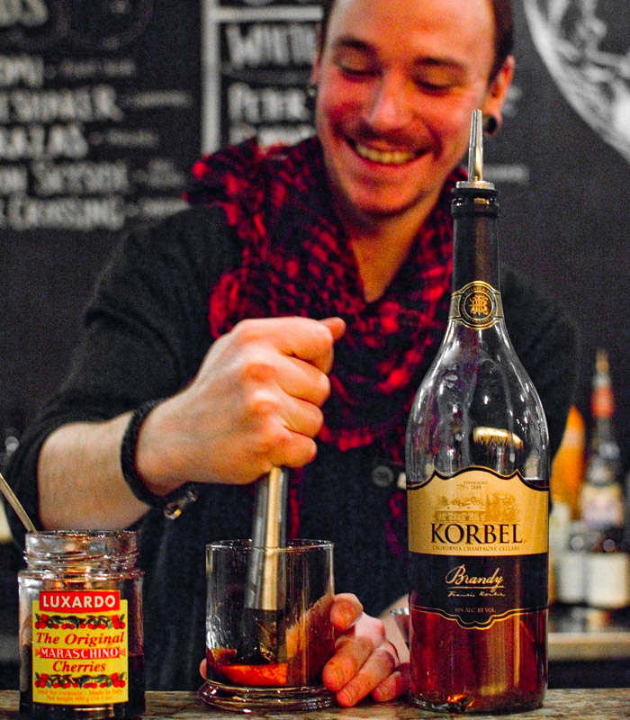 JavaVino Bartender Mixing an Old Fashioned Cocktail